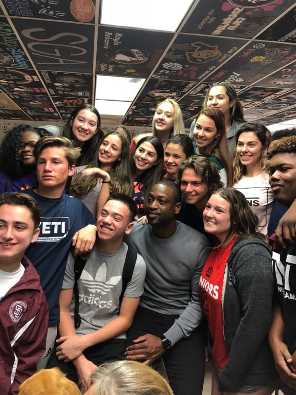 Wade poses with students during his surprise visit