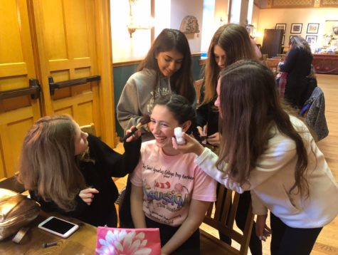 Makeup girls working their magic on Lily Dahlborn '22.