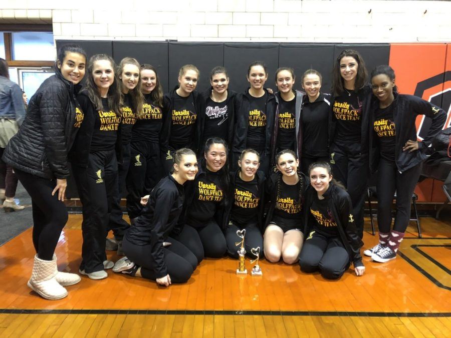 SICP+Dance+Team+poses+with+their+1st+and+4th+place+trophies+after+their+performances+at+Glenbard-South+High+School+on+December+1st.