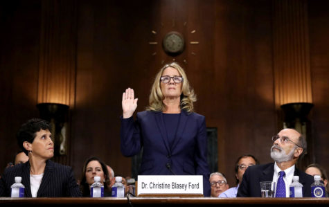 "WASHINGTON, DC - SEPTEMBER 27:  Christine Blasey Ford (C) is sworn in before testifying the Senate Judiciary Committee with her attorneys Debra Katz (L) and Michael Bromwich (R) in the Dirksen Senate Office Building on Capitol Hill September 27, 2018 in Washington, DC. A professor at Palo Alto University and a research psychologist at the Stanford University School of Medicine, Ford has accused Supreme Court nominee Judge Brett Kavanaugh of sexually assaulting her during a party in 1982 when they were high school students in suburban Maryland. In prepared remarks, Ford said, ""I don"