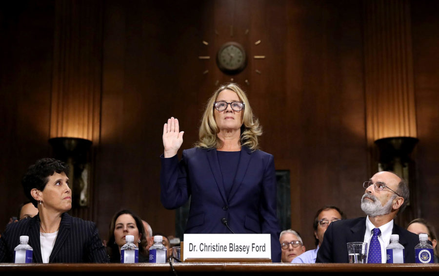 WASHINGTON%2C+DC+-+SEPTEMBER+27%3A++Christine+Blasey+Ford+%28C%29+is+sworn+in+before+testifying+the+Senate+Judiciary+Committee+with+her+attorneys+Debra+Katz+%28L%29+and+Michael+Bromwich+%28R%29+in+the+Dirksen+Senate+Office+Building+on+Capitol+Hill+September+27%2C+2018+in+Washington%2C+DC.+A+professor+at+Palo+Alto+University+and+a+research+psychologist+at+the+Stanford+University+School+of+Medicine%2C+Ford+has+accused+Supreme+Court+nominee+Judge+Brett+Kavanaugh+of+sexually+assaulting+her+during+a+party+in+1982+when+they+were+high+school+students+in+suburban+Maryland.+In+prepared+remarks%2C+Ford+said%2C+%22I+don%27t+have+all+the+answers%2C+and+I+don%27t+remember+as+much+as+I+would+like+to.+But+the+details+about+that+night+that+bring+me+here+today+are+ones+I+will+never+forget.+They+have+been+seared+into+my+memory+and+have+haunted+me+episodically+as+an+adult.%22++%28Photo+by+Win+McNamee%2FGetty+Images%29