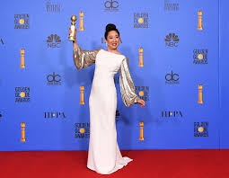 Sandra Oh pictured holding her Golden Globe for Best Actress in TV Drama.