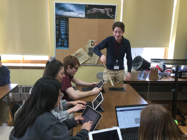 Will Hiteshew '19 guides his team, QuickFinder, in a brainstorming session.