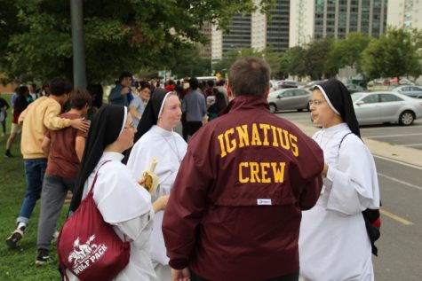 Sisters of SICP talk the walk with Father Caruso.