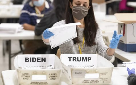 An election worker organizing recounted ballots in Marietta, Ga. Courtesy of John Amis for Associated Press