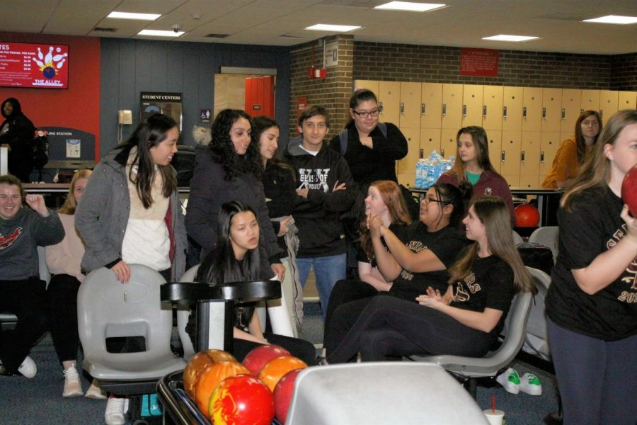 The St. Ignatius Bowling Team shares a laugh.
